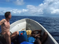 In the banana boat on the way to next target island.